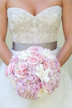 This wedding bouquet with pink hydrangeas and roses is just divine! // Via Tulle & Chantilly
