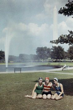 Three girls pose in front of a fountain near the Washington Monument, ca. 1930