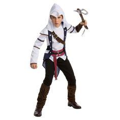 Ce costume pour adolescent du personnage de Connor sous licence officiel du jeu vidéo Assassin's Creed™ est composé d'une tunique, d'un pantalon et d'une capuche. Disponible en 10/12 ans ou 12/14 ans. La tunique représente une veste avec un haut directeme