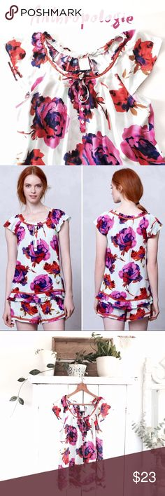 Anthro floral flutter sleeve blouse This top is so cute! Part of their sleepwear line, but I would totally wear it as a top out and about! ;) Good condition...except for one tiny pull and two holes I fixed. Completely unnoticeable due to it being on the flutter sleeve. See pictures. Priced to sell! Gorgeous light blue background with large rose pattern. Size medium. Bust 19 inches. Length 26 inches. Anthropologie Tops Blouses