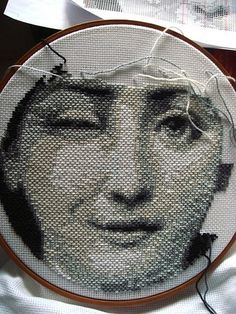 Fornasetti inspiration worked on Aida cloth...traditionally cross stitch is worked on this cloth...like the horizontal stitch used...gives a very different texture to the piece