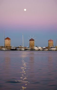 Greece Pink sunset in Rhodes Town, moon rising
