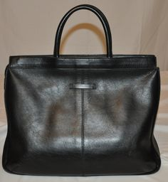 Jean Paul Gaultier black leather tote bag | From a collection of rare vintage tote bags at https://www.1stdibs.com/fashion/handbags-purses-bags/tote-bags/