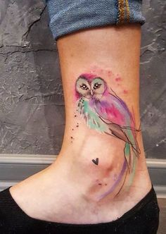 0f9e49c314341 Bright and colorful watercolor owl done on girl's ankle by Simona Blanar,  an artist based in Prague, Czech Republic.