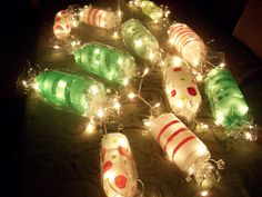 Light up Candy Garland.. Cut ends off soda bottles paint candy stripes wrap in clear cellophane tie with balloon string on an indoor outdoor string of white lights....