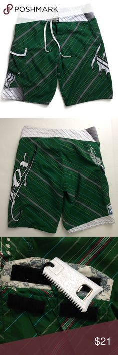 "FOX Boardies Sz 36 Shorts Pocket w/ Bottle Opener Fox Boardies with Attached Bottle Opener in Pocket Size:  36 Color:  Green with white, black, red, & blue Design:  Diagonal Striped with Fox Embroidered Applique' Fabric:  100% Polyester  Features: 	•	Hook & loop fly fastener with tie waistband 	•	Side pocket with bottle opener attached inside  	 Measurements: Waist:  18"" (measured laying flat, side to side) Inseam:  12"" Length:  23"" Pre-owned, good used condition with normal wear.  No rips…"