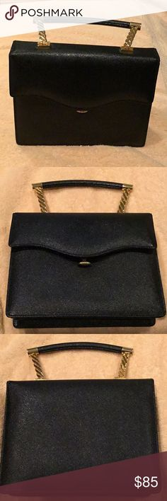 Beautiful Black Vintage Mahon Purse Absolutely gorgeous purse in beautiful condition, purchased at an upscale vintage consignment store, the handle looks like brass with a bar that is covered in black leather, purses apps salute Lee gorgeous. Manon Bags