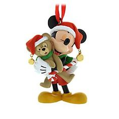 Mickey Mouse and Duffy Figural Ornament | Disney Store Mickey and his traveling companion Duffy the Disney Bear get in the holiday spirit with this finely detailed figural ornament. With jingle bells hanging from their Santa hats, the pair prepare to ring in the festive season.