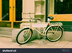 http://www.shutterstock.com/pic-201846319/stock-photo-classic-vintage-retro-city-bicycle-in-stockholm-sweden.html?src=z1Js5wc…