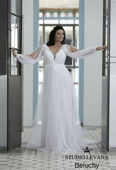 Plus size lace long sleeves wedding gown with a tulle skirt