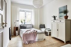 When it comes to stylish boudoirs, the Swedes have it on lock, and this light-filled version is proof. It's streamlined, clutter-free, and simple with a pendant light we can all get behind. We can...