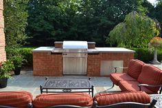 Custom brick BBQ with a polished bluestone countertop.