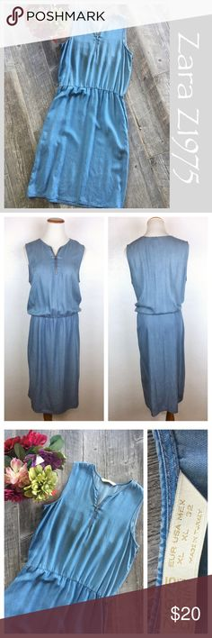 """Zara Z1975 Denim Chambray Dress. Zara Denim Z1075 chambray Denim Dress. Elastic waist, side belt loops, 2 pockets and front zipper detail. Popover dress. Preowned. Size XL. #339 Measurements: 20 """" across bust. 17 1/2 inches across the waist… Remember it has stretch. 37 1/2 inches from underarm to bottom hem. Skirt portion measures 26 1/2 inches in length.  Bundle in my closet and save. I ship same day or next day almost always! No PayPal's or trades. Suggested user and top rated seller…"""