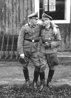 Two buddy SS officers at the Neuengamme concentration camp, 1944.