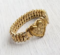 Hey, I found this really awesome Etsy listing at http://www.etsy.com/listing/126135928/sale-vintage-heart-bracelet-mid-century