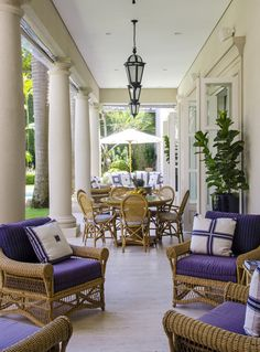 Rua Turquia patio with wicker seating Colonial Neoclassical Mediterranean Patio Portico by Sig Bergamin