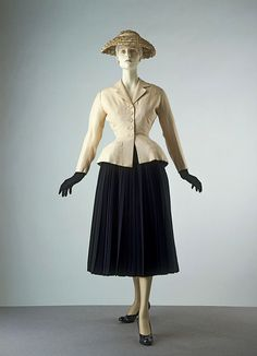 The New Look Dior (French) ca. 1947 Plain weave silk tussore and pleated wool crepe, mounted on stiffened taffeta