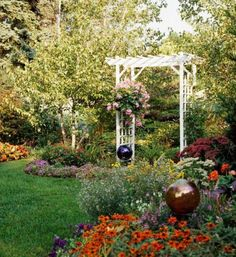 If your yard lacks a view, create one. Gazing balls and an arbor add special touches in this Wisconsin garden. More beautiful backyards: http://www.midwestliving.com/garden/ideas/30-beautiful-backyards/page/17/0
