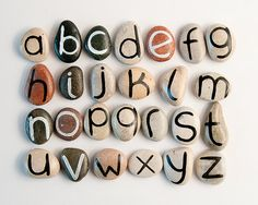 "Alphabet Magnets on Beach Pebbles ("",)"