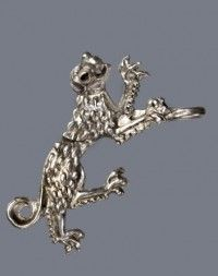 A silver heraldic wild-cat dress-pin. A sewing hole is formed in the opened mouth a sewing hole, and the tail is rolled into a circular loop, which was also used as a sewing hole. From the Thüringisches Landesamt für Denkmalpflege und Archäologie.