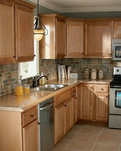 More realistic idea for current kitchen, size-wise. Tan Kitchen Cabinets, Neutral Cabinets, Home Depot Cabinets, Kitchen Reno, Home Depot Kitchen, 1970s Kitchen Remodel, Brown Cabinets, Kitchen Remodeling, Galley Kitchen Remodel
