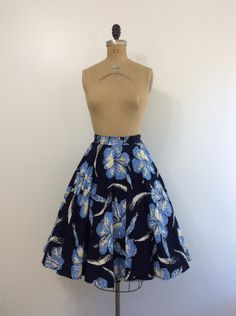A personal favorite from my Etsy shop https://www.etsy.com/listing/462716951/1950s-surf-and-sand-hibiscus-skirt-50s