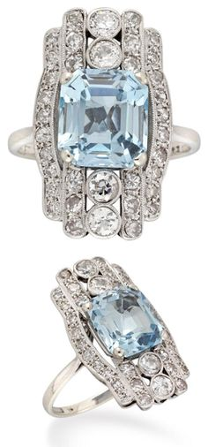 Late Art Deco ring ~ with a 3.22 carat aquamarine set within a fancy diamond set surround, millegrain-set to a pierced mount hallmarked 18 carat white gold.