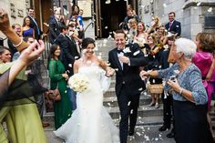 Best of Caprisio Weddings - Leaving the church as everyone throws flower petals.
