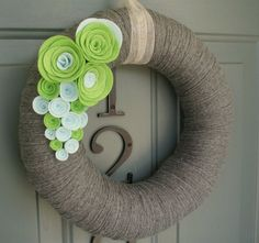 Spring Wreath.  I love the twine; if you could make flowers for every season that could be pinned on and removed, this could work year-round...