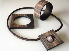 Faux wood jewellery made from polymer clay by Angela Garrod of claynine.