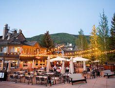 outdoor reception with cafe lights in aspen colorado rustic wedding venue