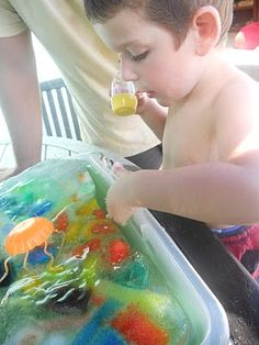 frozen fun-- freezing toys and letting the kiddos figure out how to unfreeze (by way of warm water, salt, sand, tools, etc).  Fun summer activity!