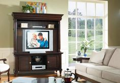 Bring style and beauty to your TV room with this lovely entertainment center available at Furniture Plus!