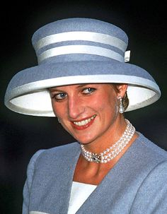 Princess Diana, October 8, 1993 | The Royal Hats Blog  Princess Diana was also in blue- a large blue lampshade style hat with white ribbon trim around the brim and wrapped around the crown designed by Philip Somerville. At the time, I believe some were surprised to see her at this wedding as she and Prince Charles had announced their separation ten months earlier and her future royal role was unclear.