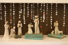 I love the nativity- propped up on aqua books and scrapbook paper stars stitched together into chains....