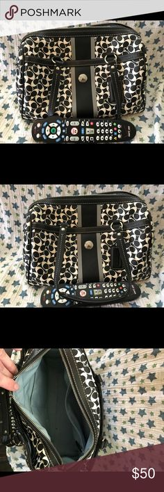 Black and white AUTHENTIC COACH HANDBAG Smooth feel over the arm handbag.  Very roomy with zippered closure and inner zippered pouch.  Two outer pockets. One on each side. Coach Bags Shoulder Bags