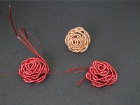 The rose ring using 18-gauge and 30-gauge red artistic wire.