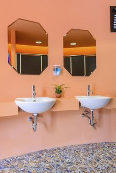 Double Suspended White Sinks Against Peach Painted Walls