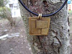 Layered textured bronze pendant