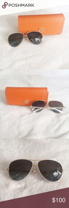 BARELY USED: Tory Burch Gold and White Aviators Gold and White Aviators from Tory Burch like new, no scratches and barely used. The purchase includes the case in the photos. Tory Burch Accessories Sunglasses