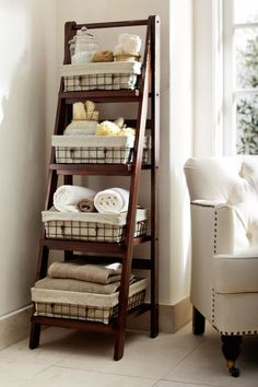 Pottery Barn – ladder shelving for Bathroom. like the wire bins with fabric lining.
