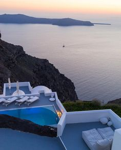 Grace Santorini is a gleaming white minimalist marvel carved out of a clifftop overlooking Skaros Rock #GraceSantorini #Santorini #Greece