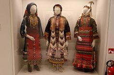 Ladies in costume.  Left:  Bridal costume from Kawakli, NE Thrace.  Middle:  female costume Eastern Thrace.  Right:  Bridal costume of Kapoutzida, central Macedona.