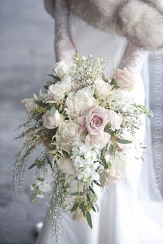 Bridal bouquet idea: cascading, predominantly white with a slight touch of pink