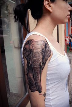 I adore elephant tattoos.  Maybe this will be my next one.  Will have to be on my leg though.  Glad I have plenty of time to it thought into since I am back to square one saving.