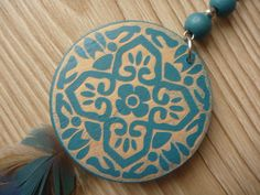 Blue earring with inlay on wood: particular.