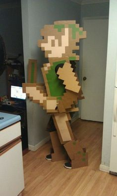 Link NES 8-bit #cosplay! Awesome! I don't know how many levels of awesomeness this is. #loz #nintendo