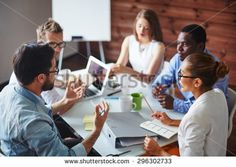 Group of multi-ethnic business partners discussing ideas - stock photo