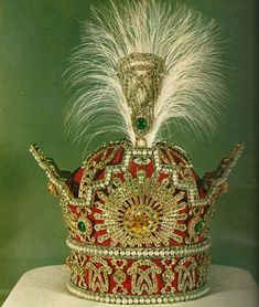 """""""The Pahlavi Crown was commissioned and first used for the coronation of Reza Shah on 25 April 1926. It was used for the last time during the coronation of his son and successor Mohammad Reza Shah Pahlavi on 26 October 1967. (…) The frame of the crown is made of gold, silver and red velvet. It has a maximum height of 29.8 cm, a width of 19.8 cm and weighs nearly 2,080 grams. A staggering 3,380 diamonds, (1,144 carats), are set into the object. The largest of these is a 60-carat (12 g) yellow…"""