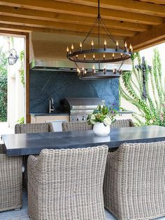 Covered patio with outdoor kitchen and dining room.  Austin Bean Design Studio.